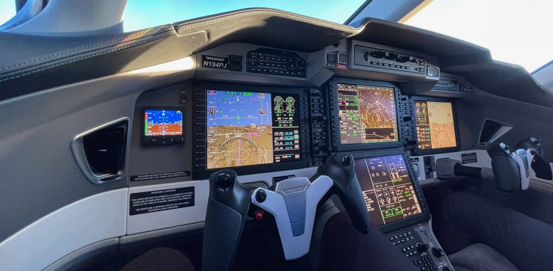 The PC-24 flight deck features a Honeywell Epic-based avionics suite, cursor-control device interface, and autothrottles.